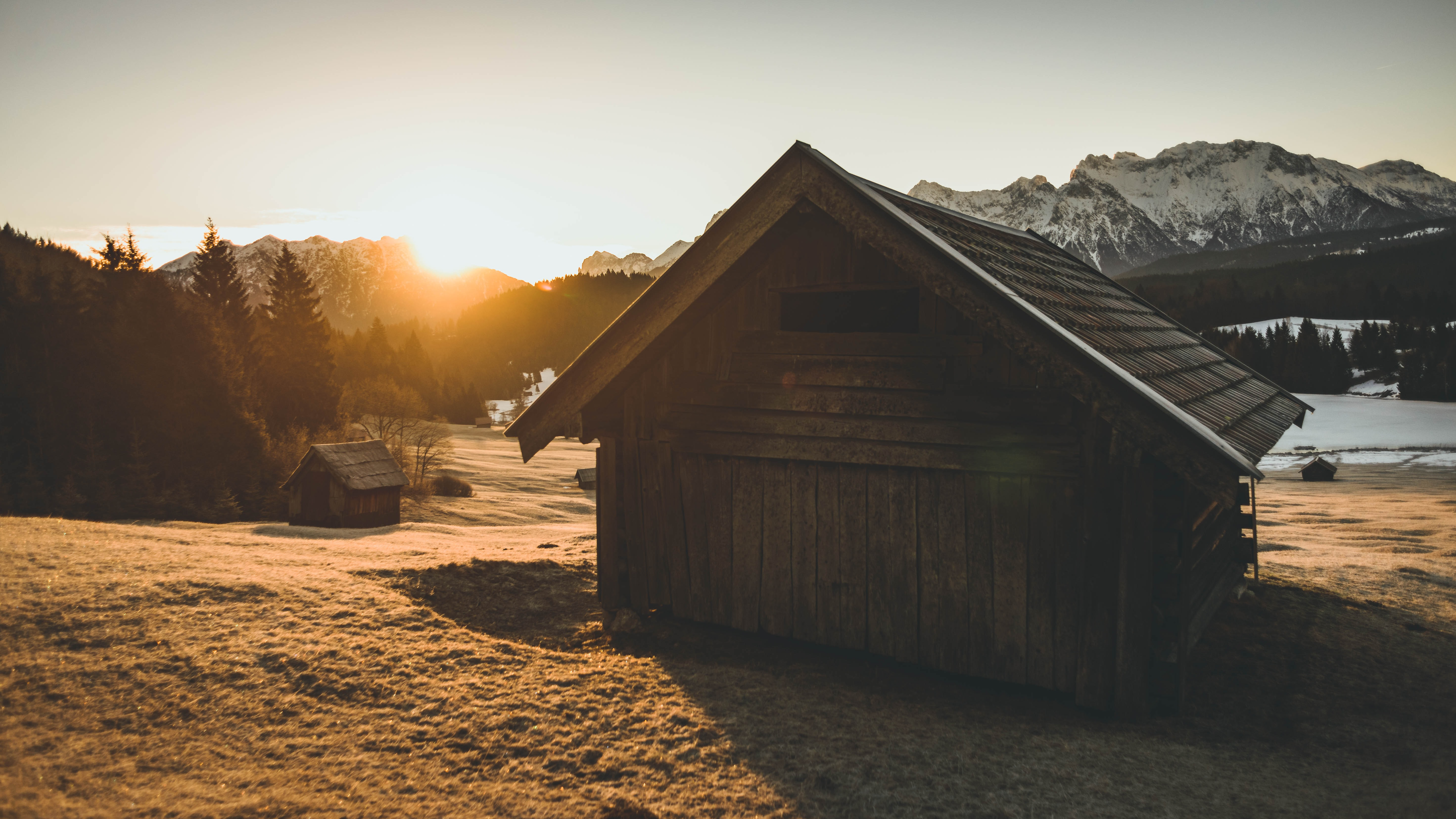 landscape photo of wooden house during sunset