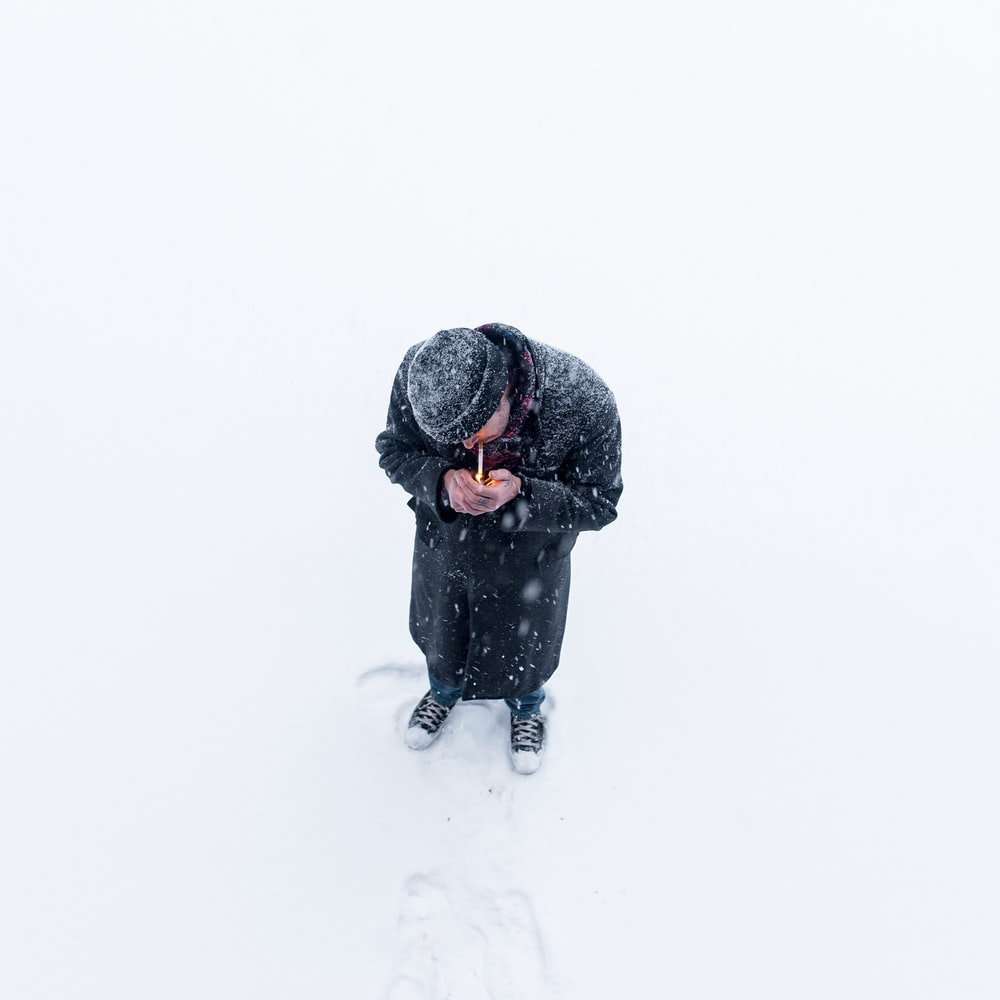 man standing on snow