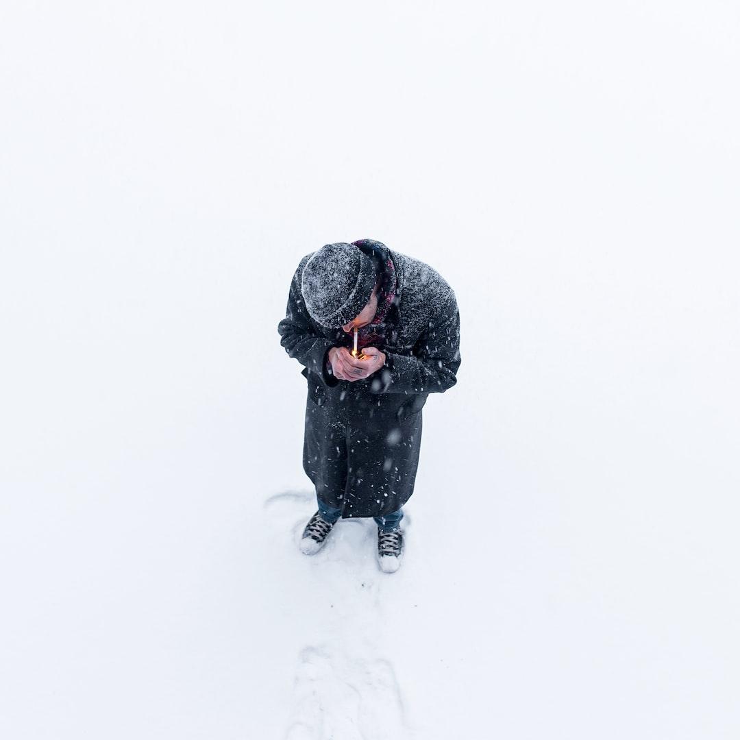 Lighting cigarette in winter
