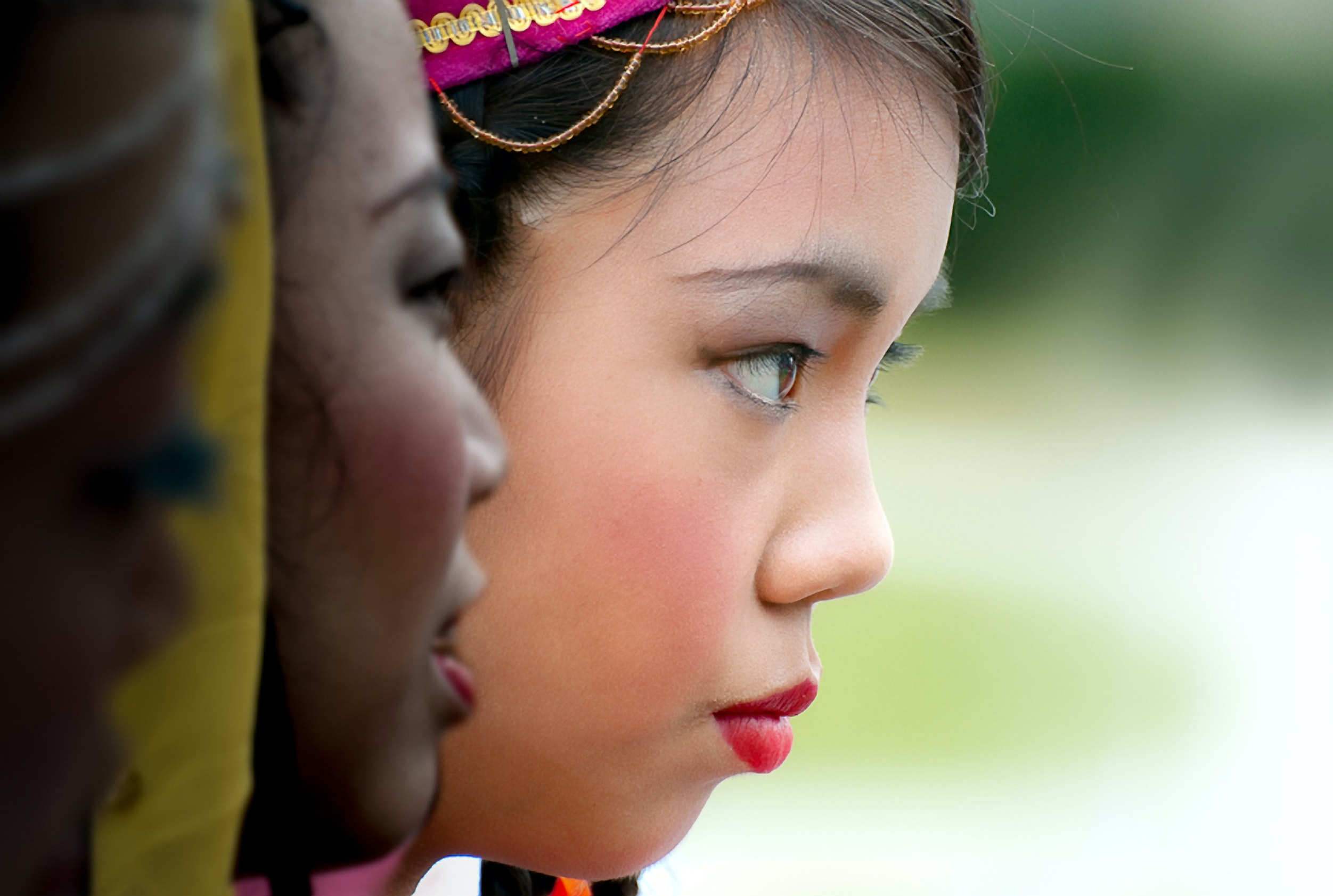 Woman standing in a line dressed up before a ceremony