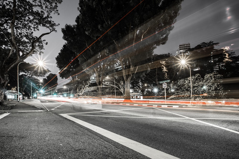light photography of street at night