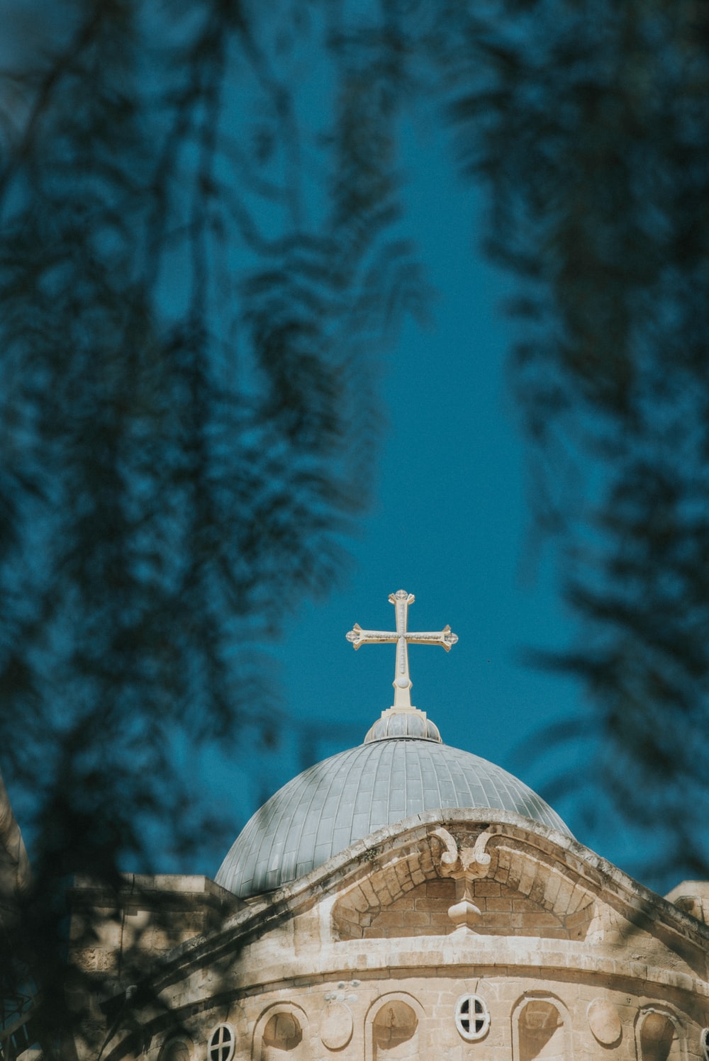 low-angle photography of white and blue church