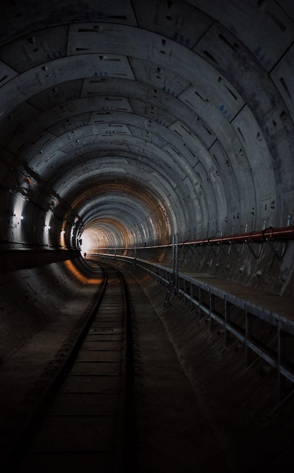 photo of train rail tunnel