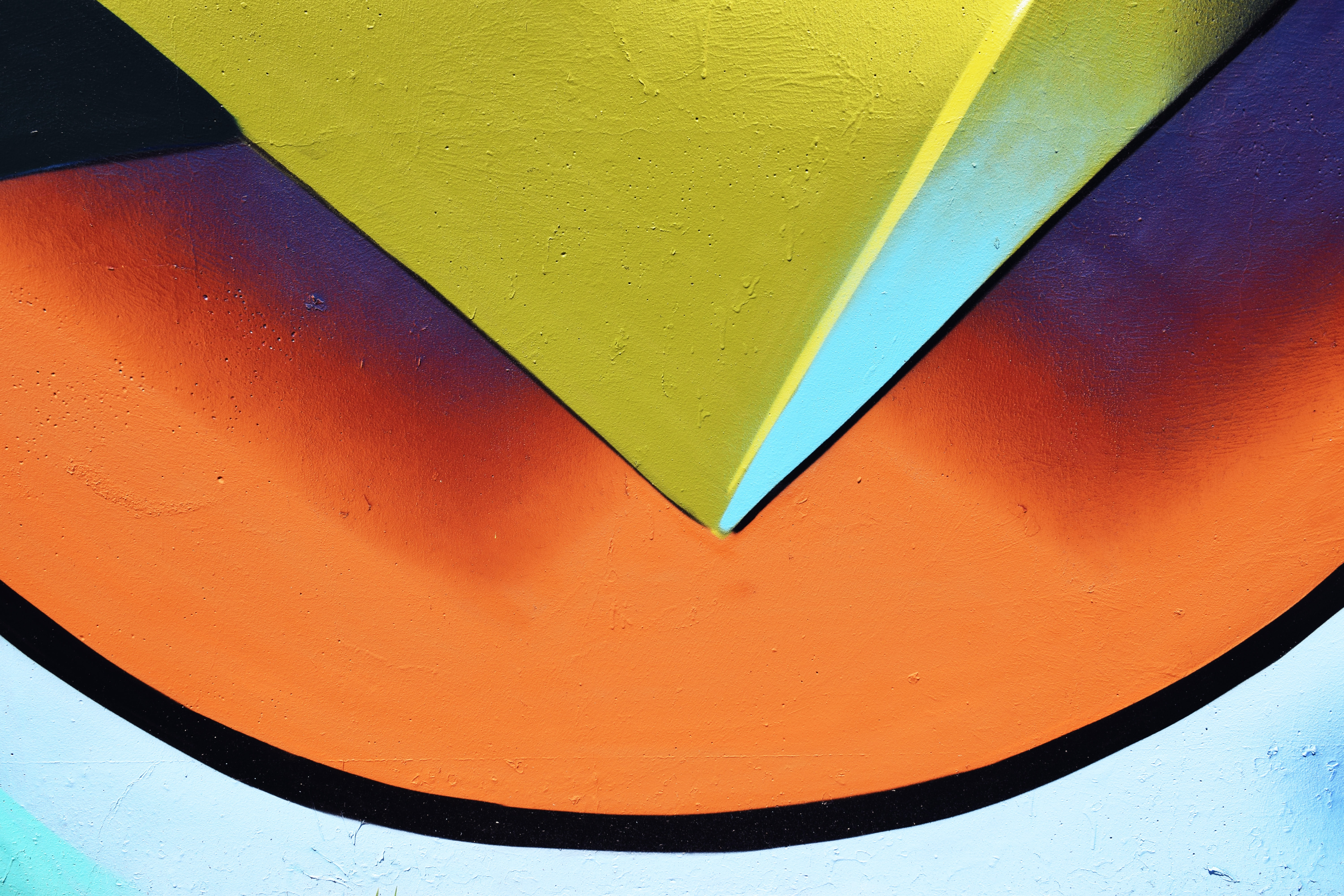 closeup photo of yellow, white, and orange painted wall