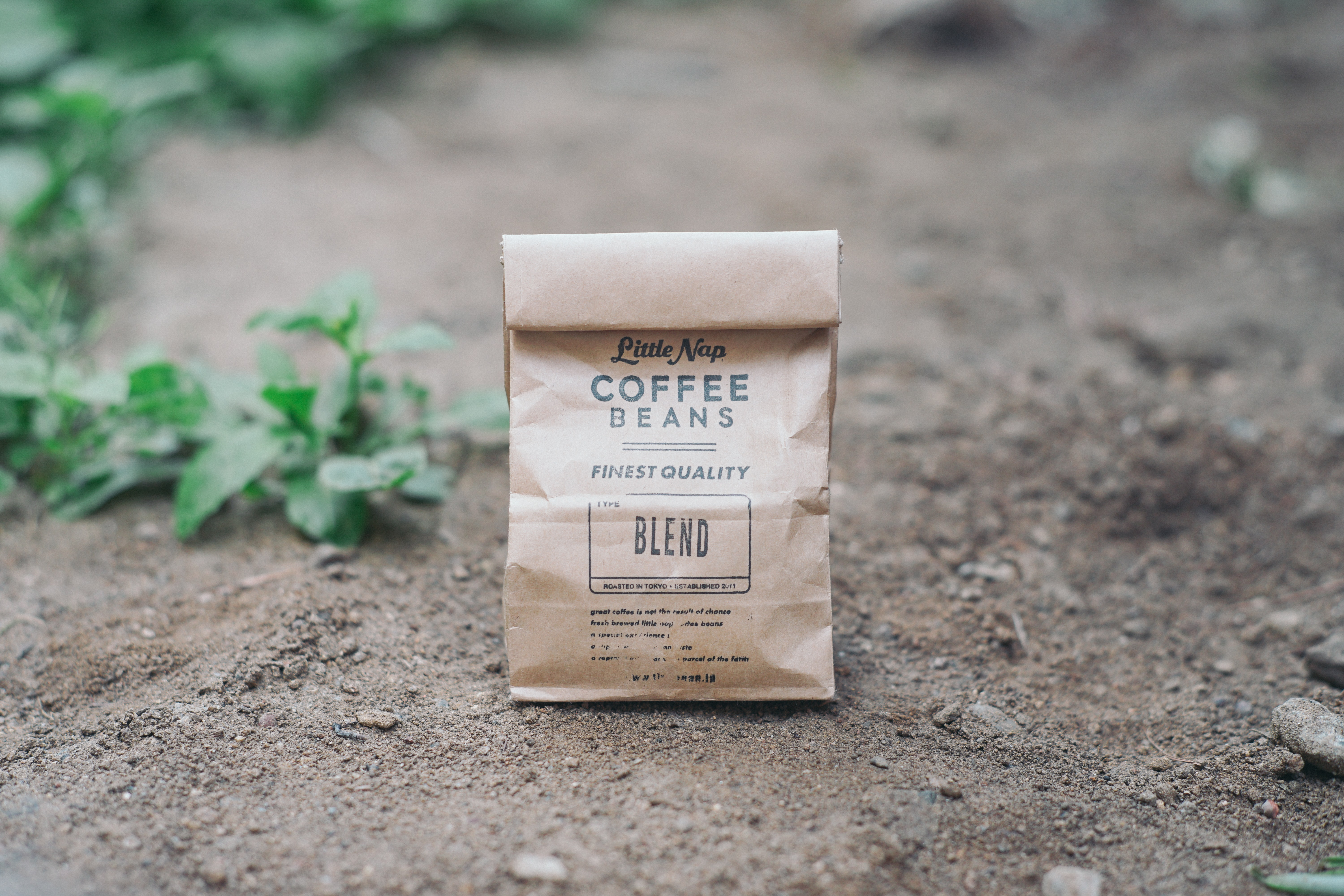 Brown bag of coffee beans outside