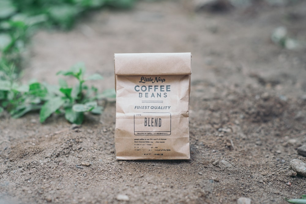 Coffee Beans blend paper bag on ground