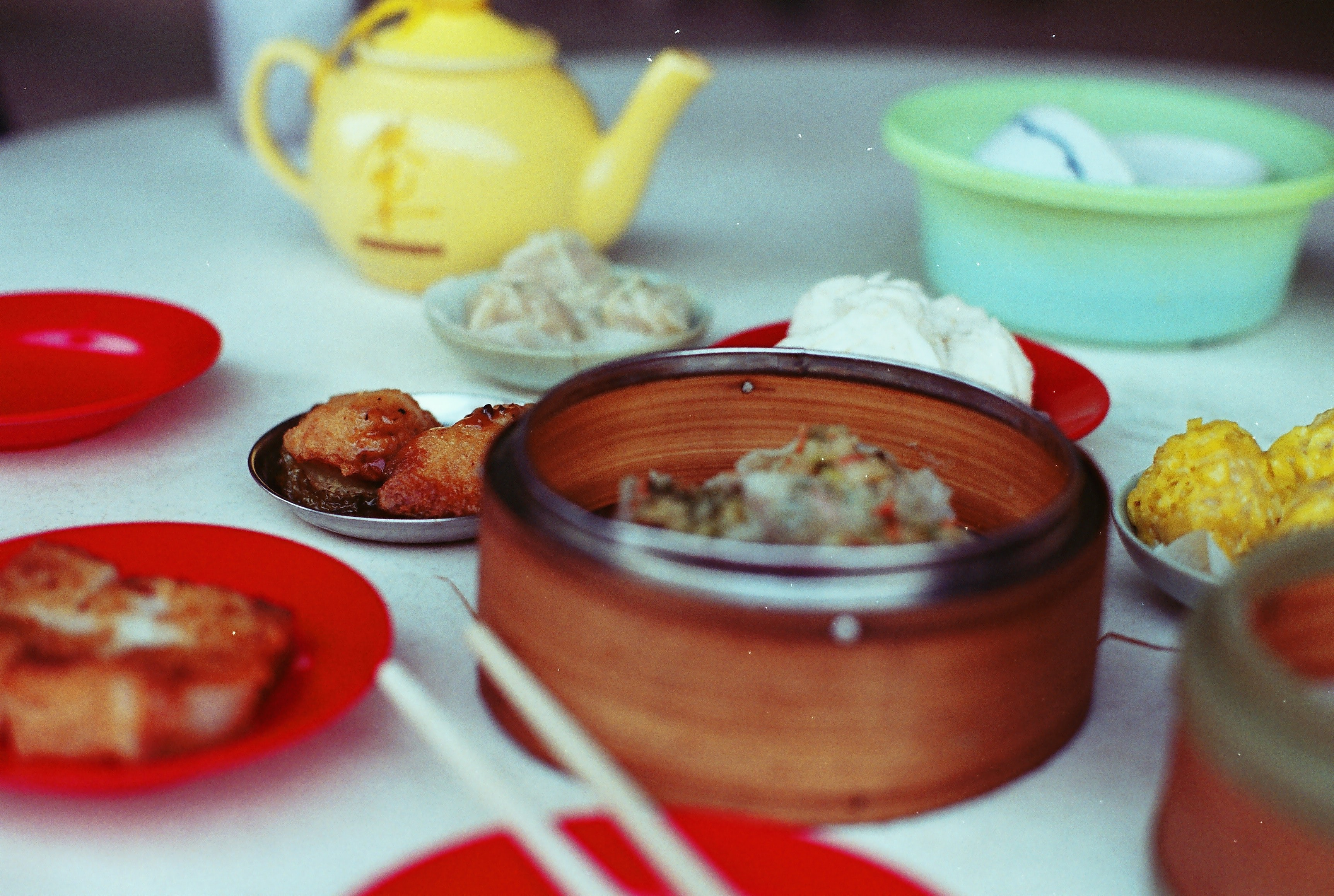 Chinese dim sum with dumplings and tea at a kitchen table