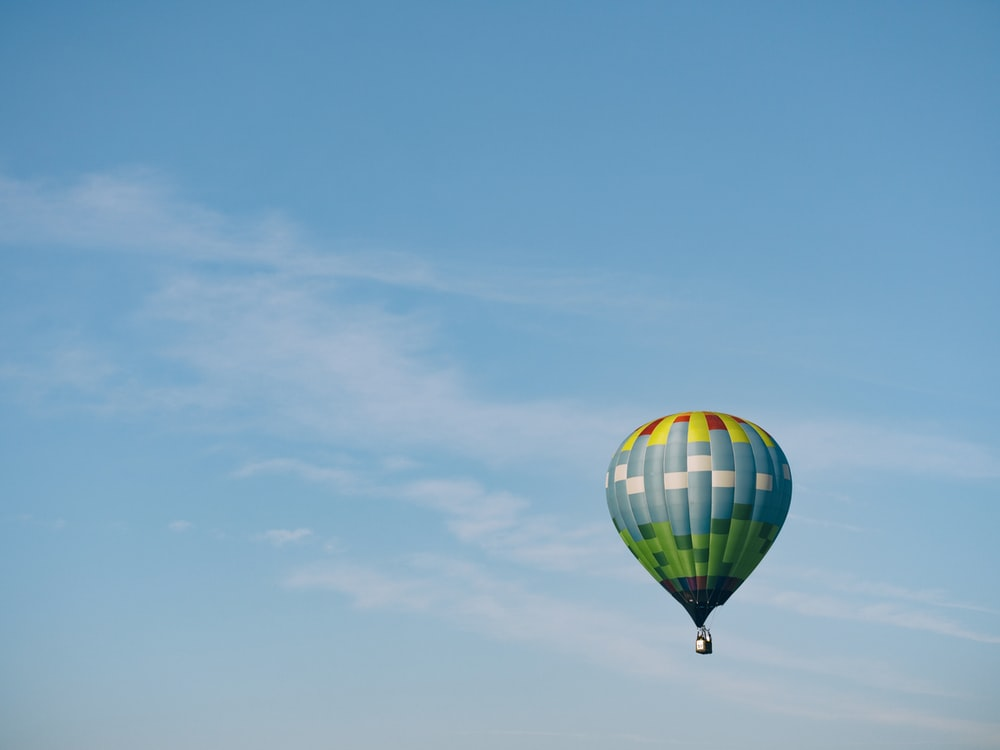multi-colored hot air balloon flying on sky