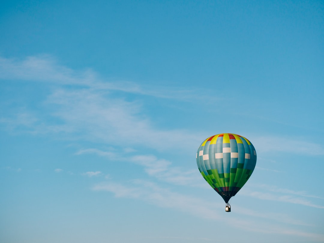 """Colorful hot air balloon in flight"""