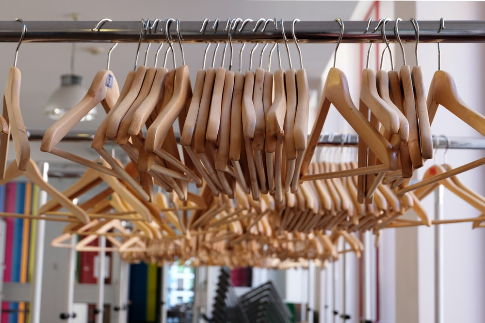 brown wooden clothes hangers on rack