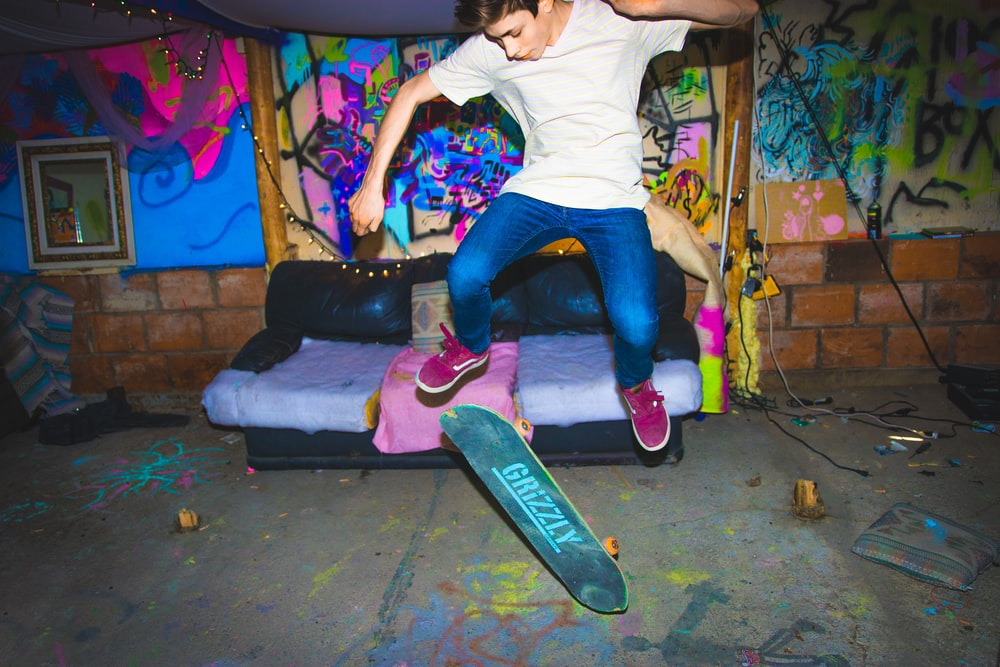 man skating near black couch