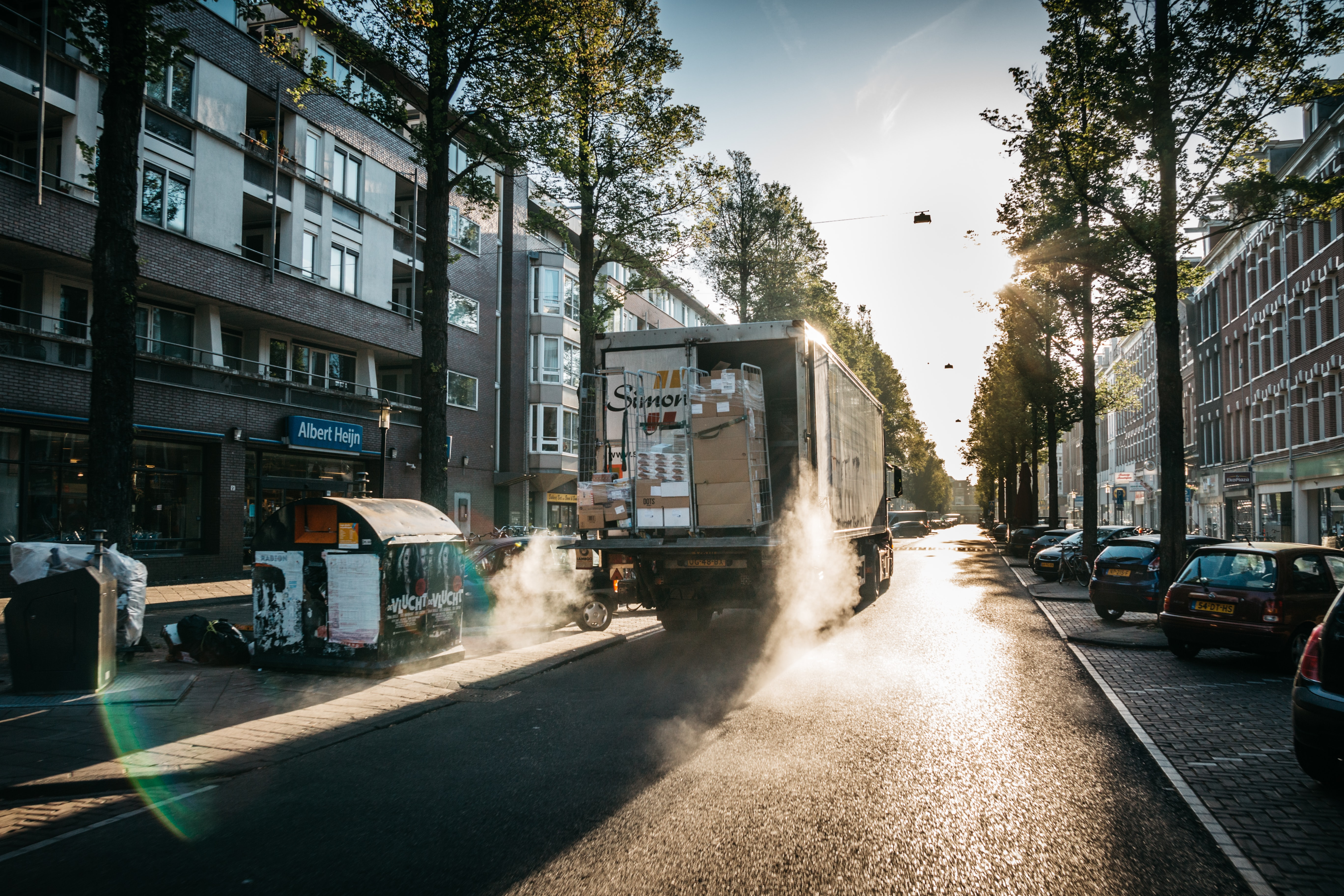 Delivery truck parked in the center of the road at sunrise