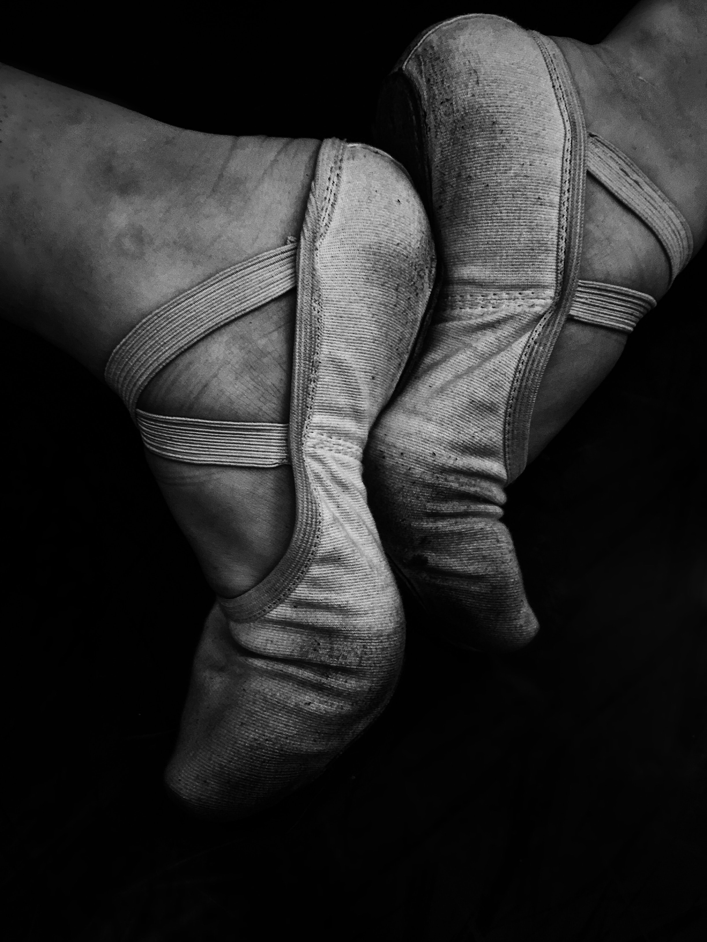 Black and white macro of pair of ballet dancers feet in training