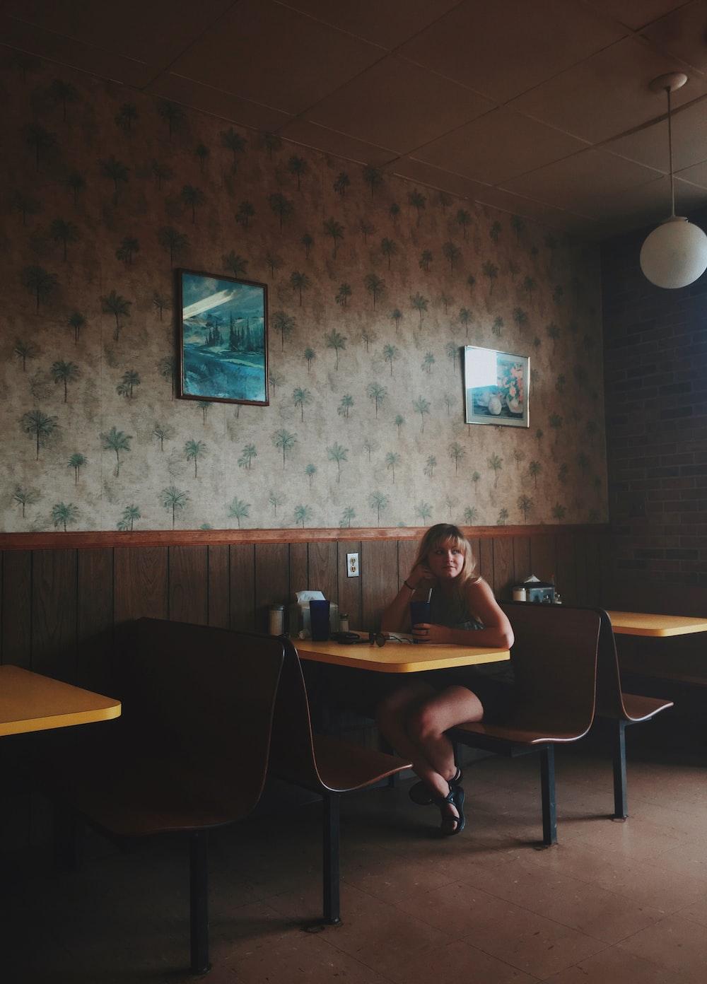 woman sitting on restaurant