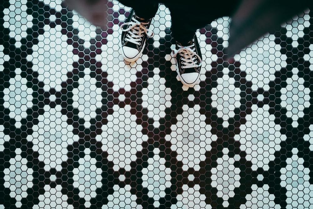 person standing wearing black sneakers