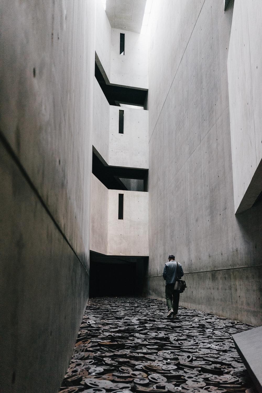 man walking in the hallwayu