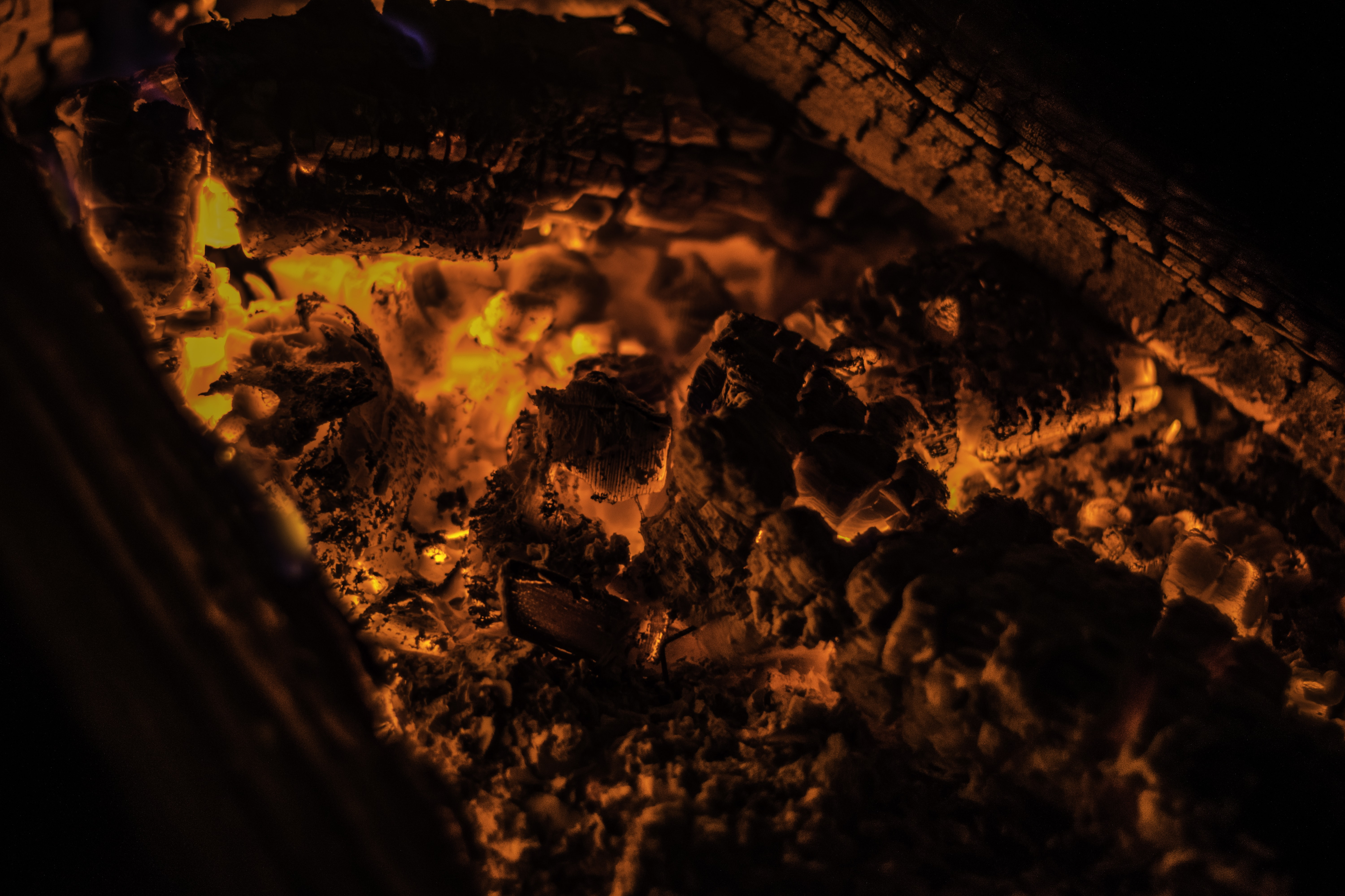 Glowing embers on hot logs in a fireplace