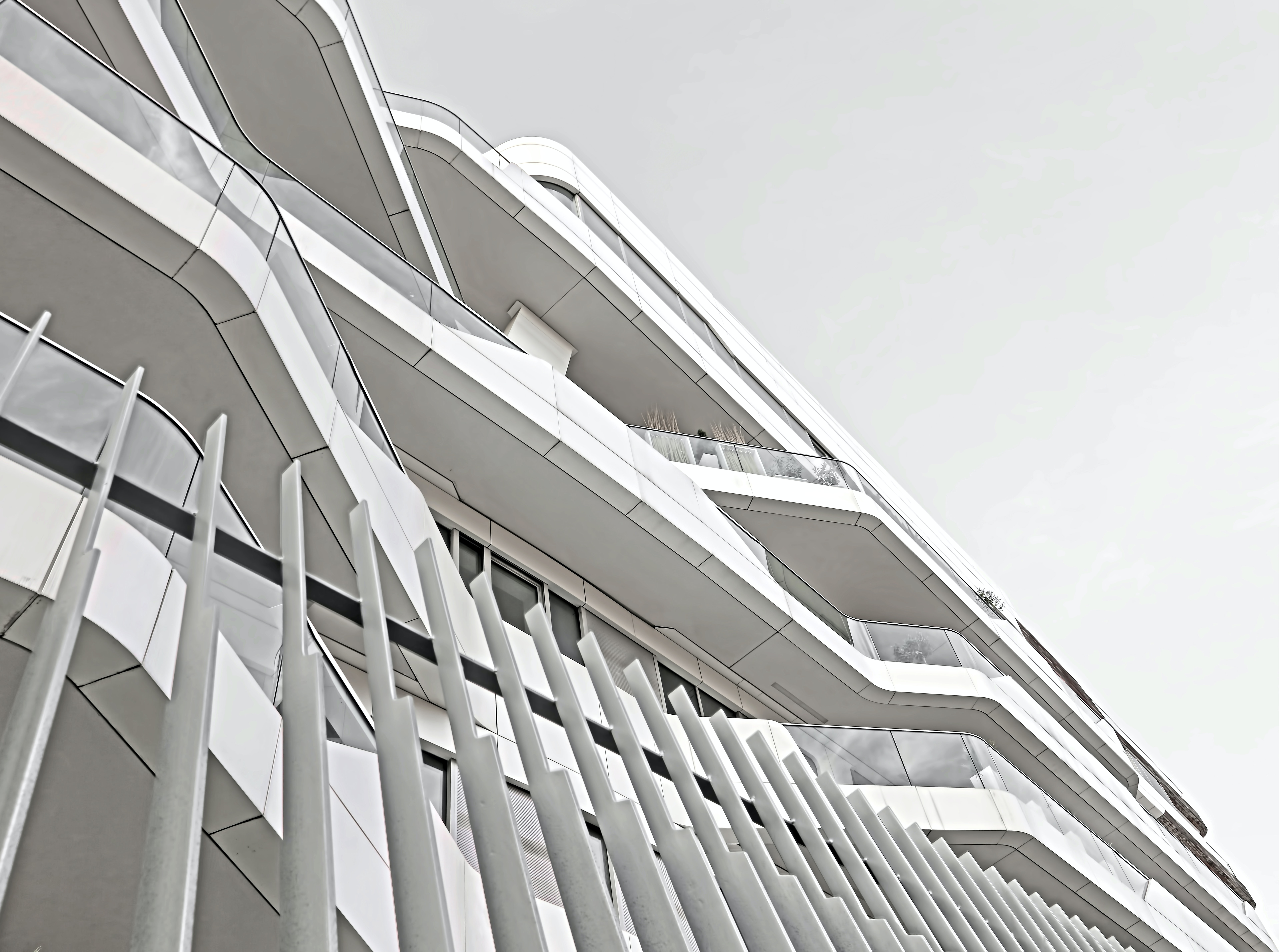 Patterns formed by unique white architecture on an office building