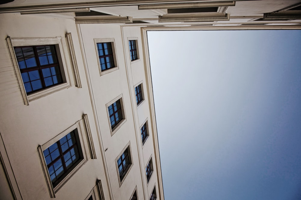 low angel photography of white building
