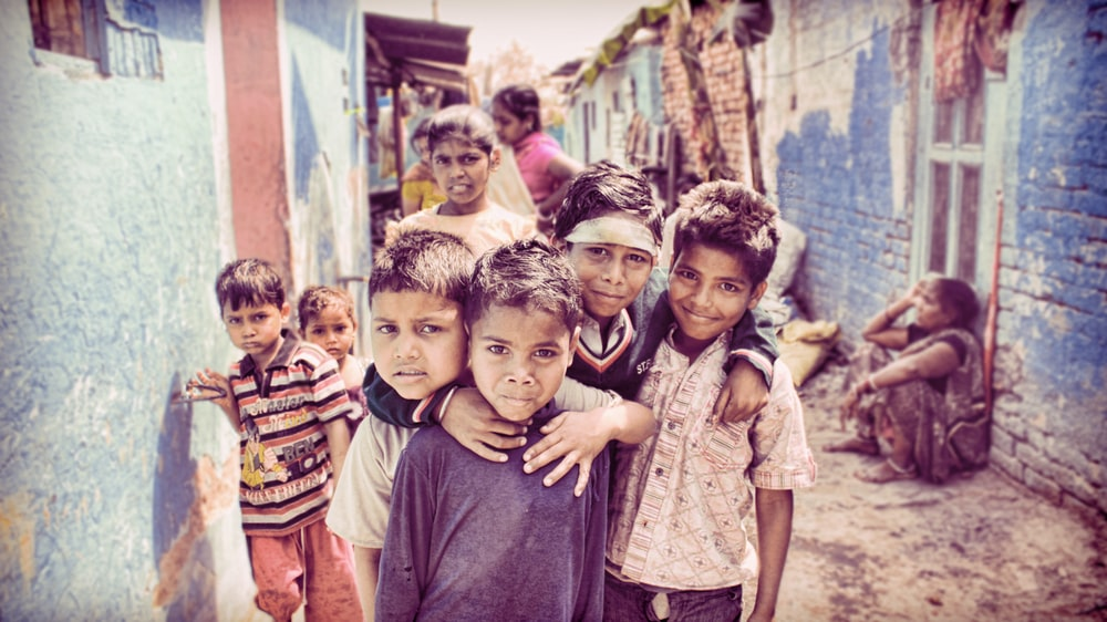 group of children nearby house