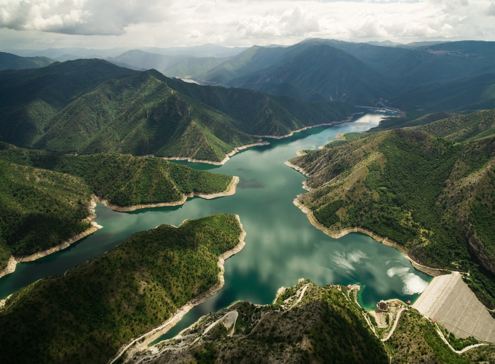 bird's eye view of river surrounded by mountains