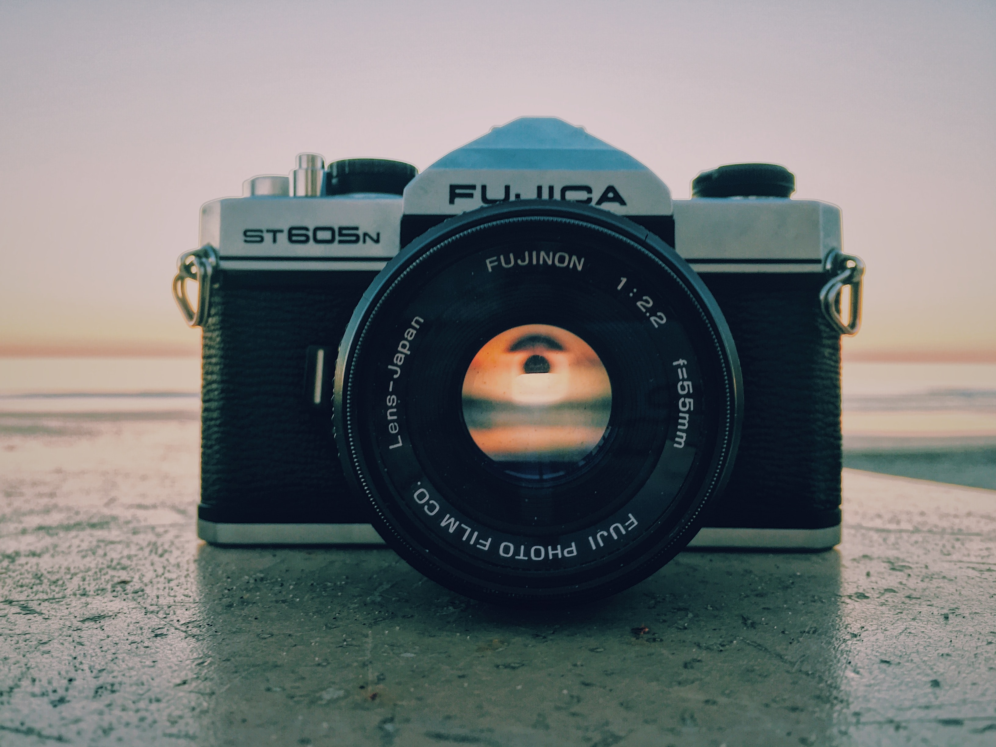 Fujica camera on a stone surface at dusk
