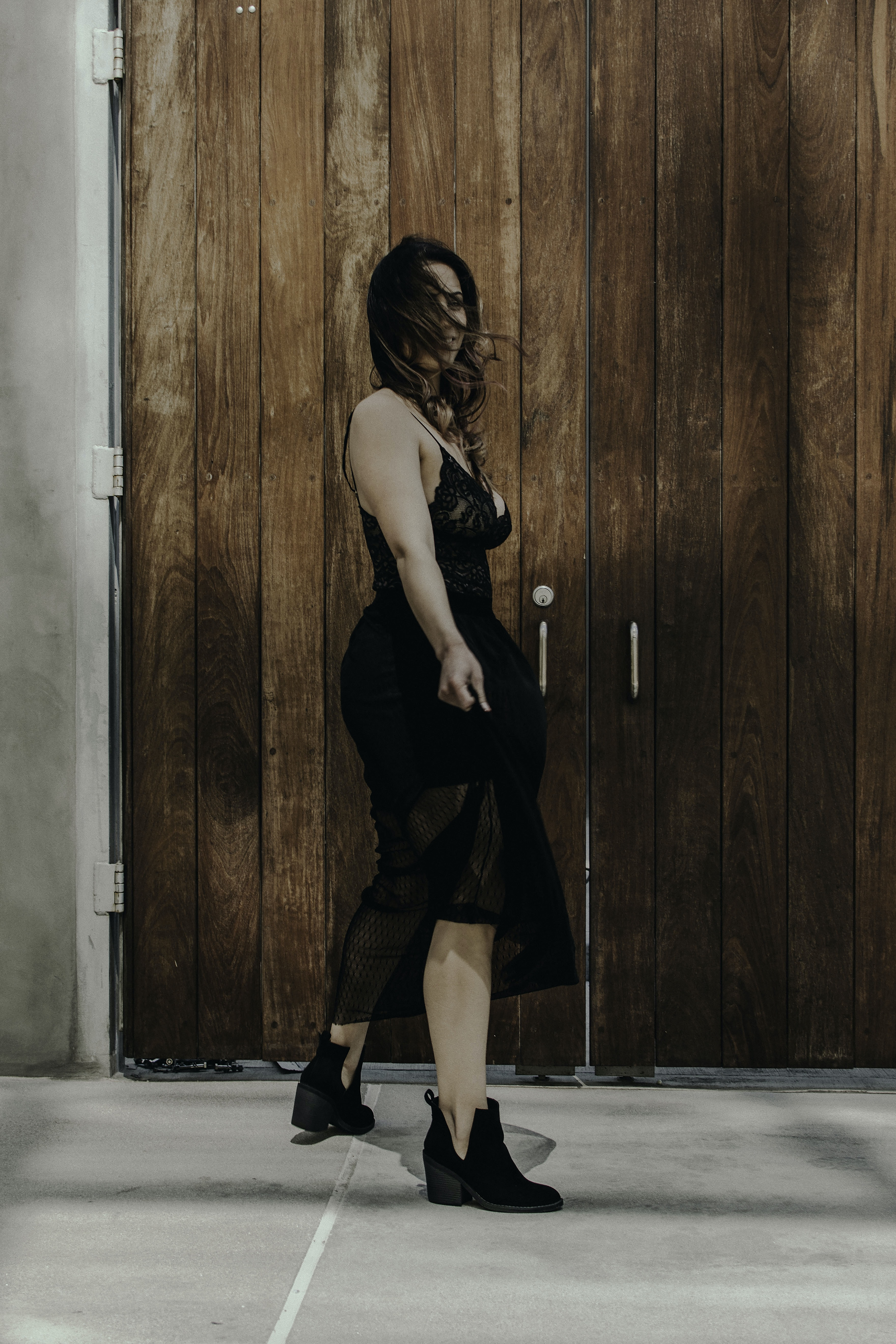 woman wearing black see-through dress