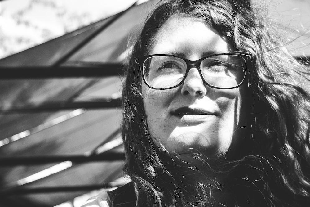 grayscale photo of woman wearing eyeglasses
