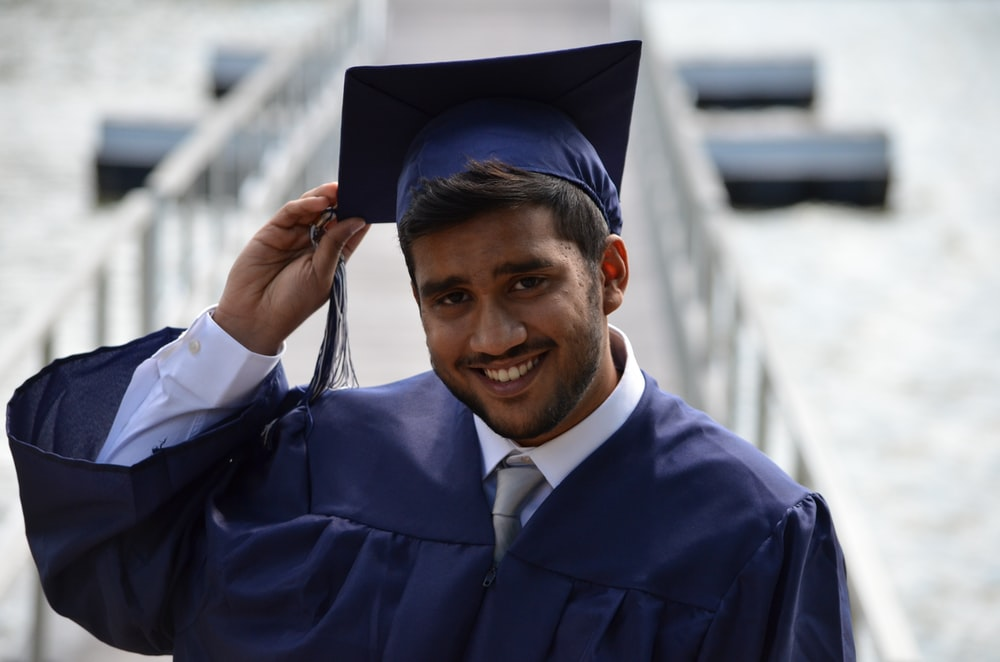 man holding his graduation cap