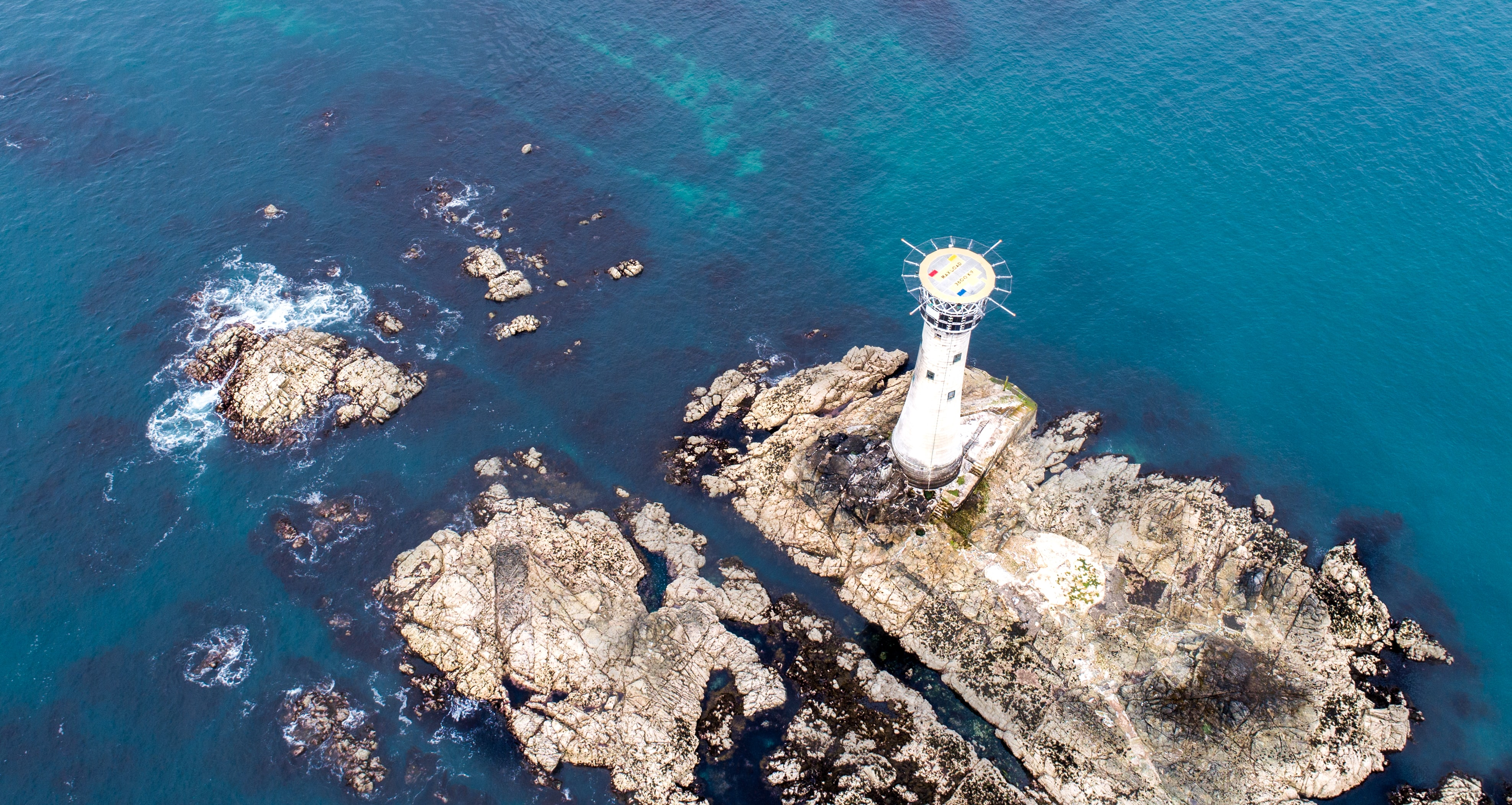 aerial photography of lighthouse near body of water