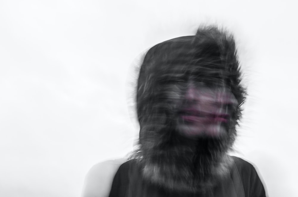 Creepy blurred photo of a person's face and a furry hood