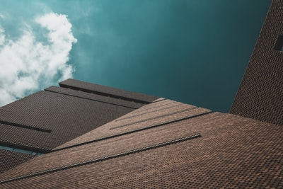 worms eye view of brown concrete building during day time