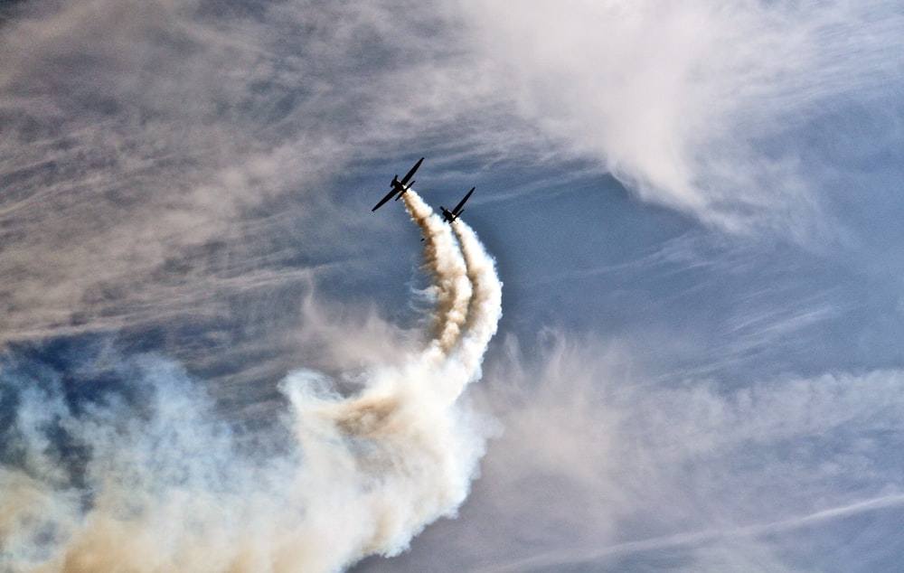 two planes with smoke trails