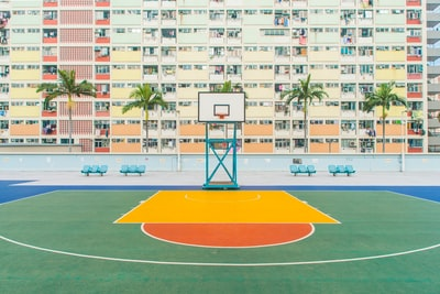basketball gym near concrete building basketball court teams background