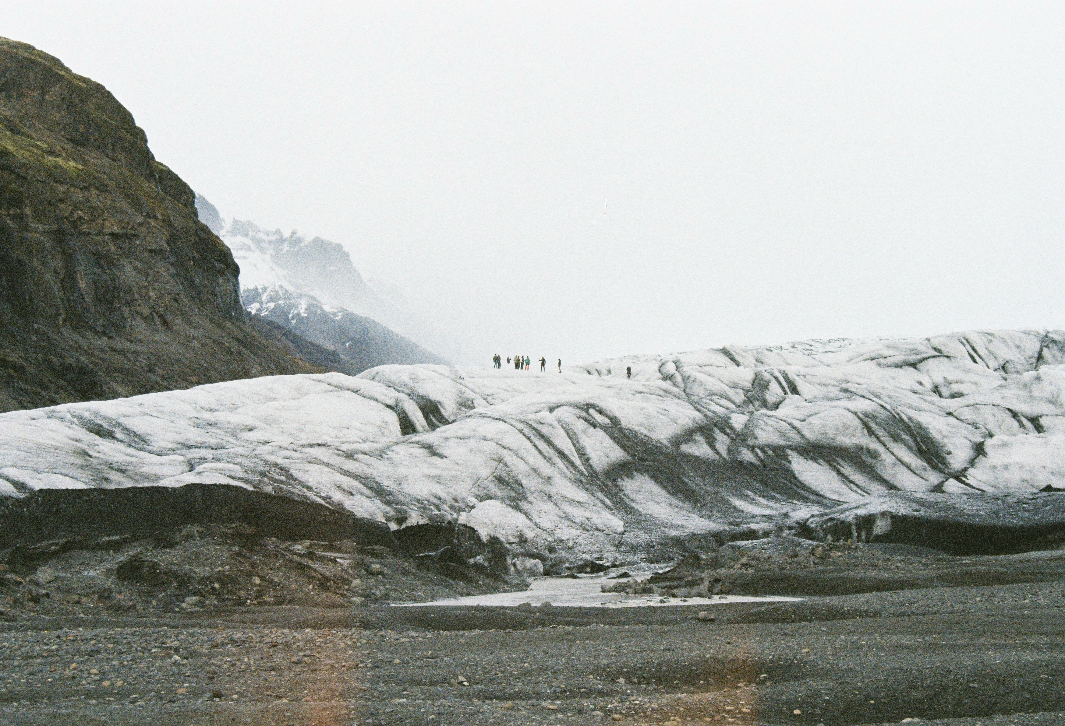 people standing on snow covered mountains during daytime