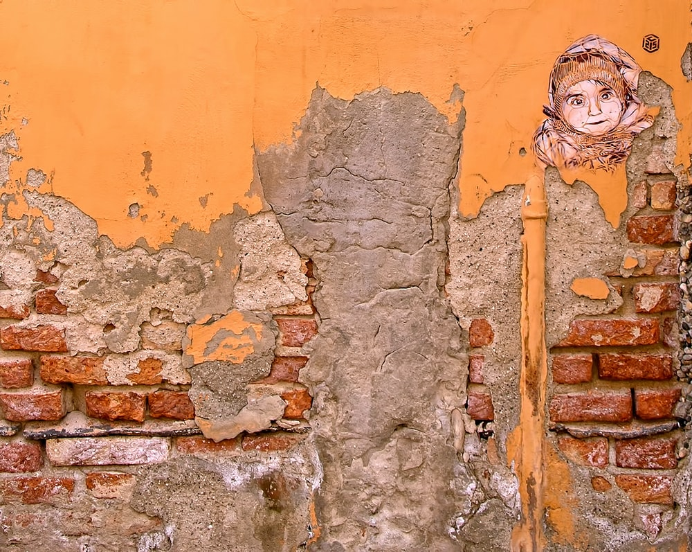 closeup photo of orange and gray wall paint