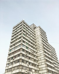 low-angle photography of grey high-rise building