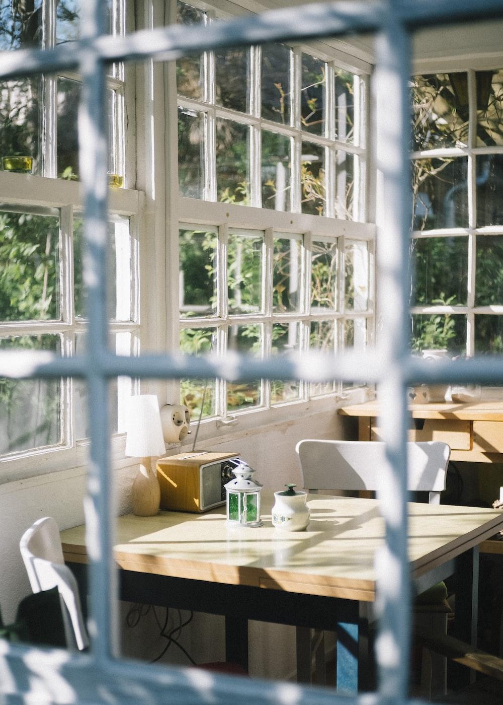 white wooden table near window