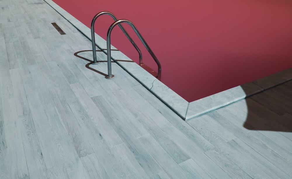 gray metal pool ladder