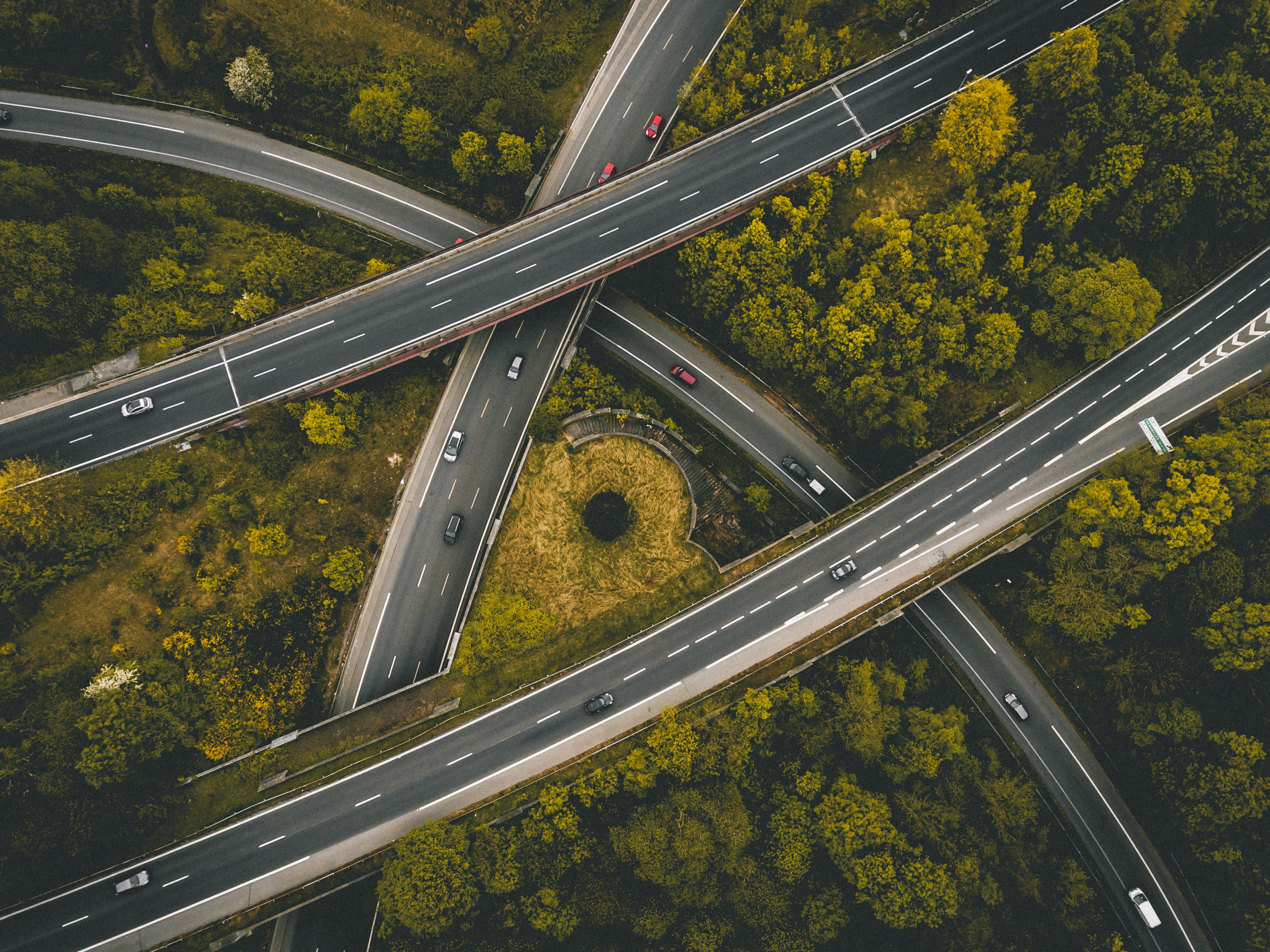 A drone shot of an intersection with an overpasses