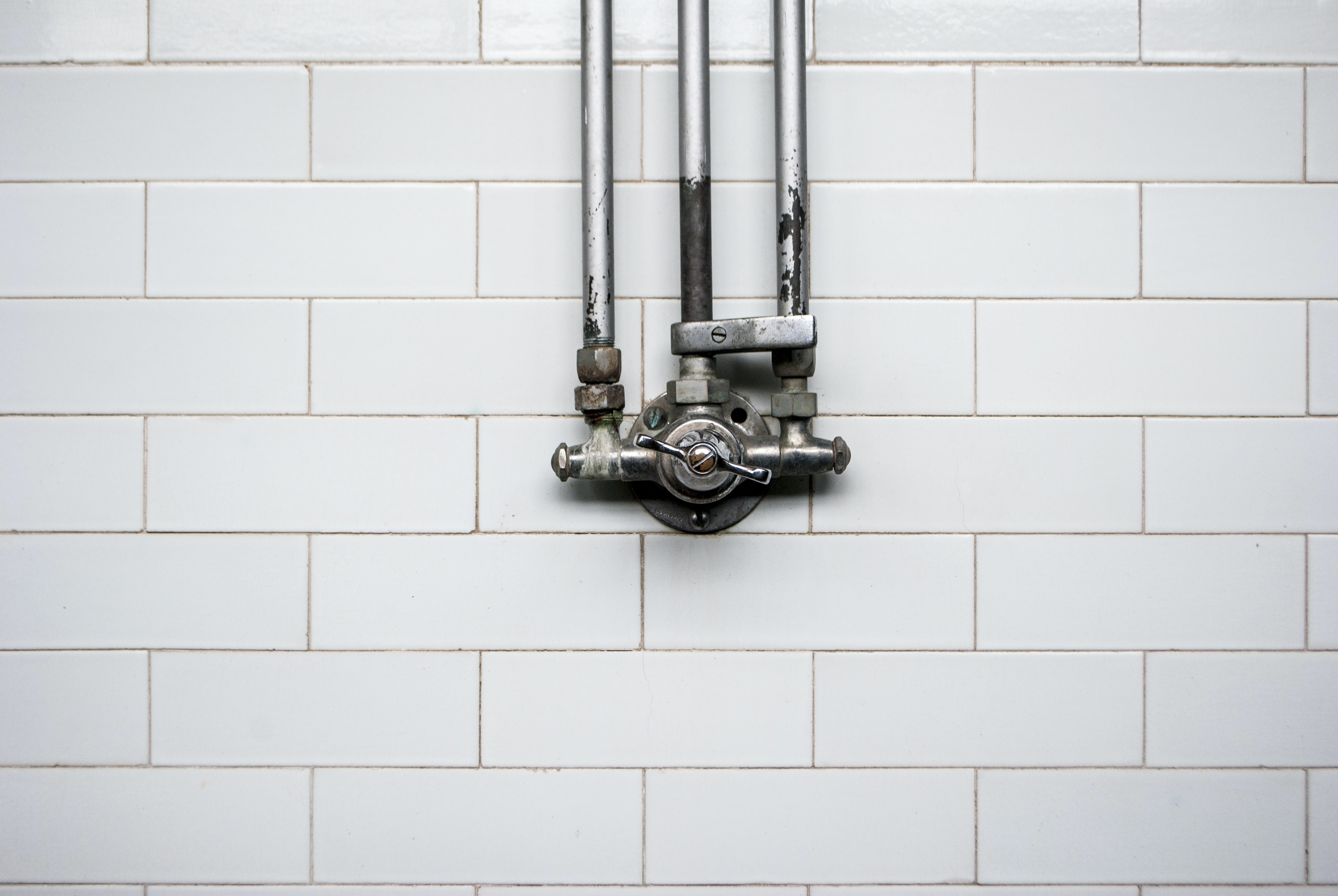 gray valve against white wall