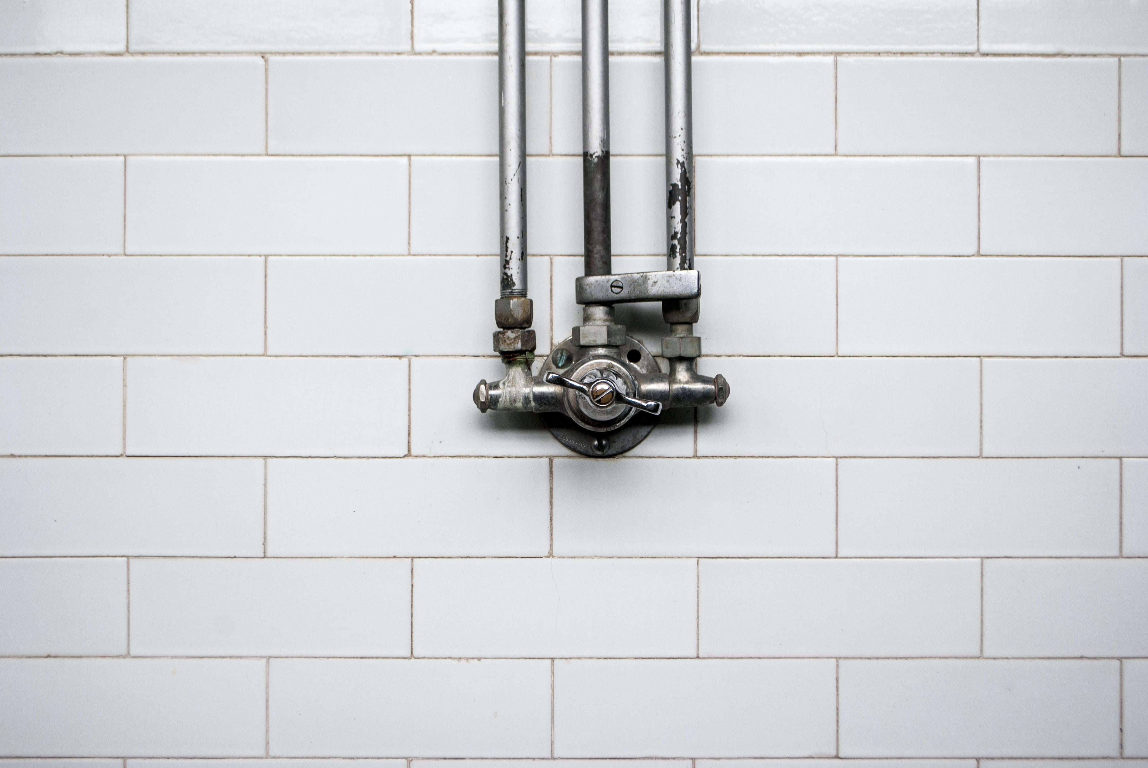 gray valve against white wall