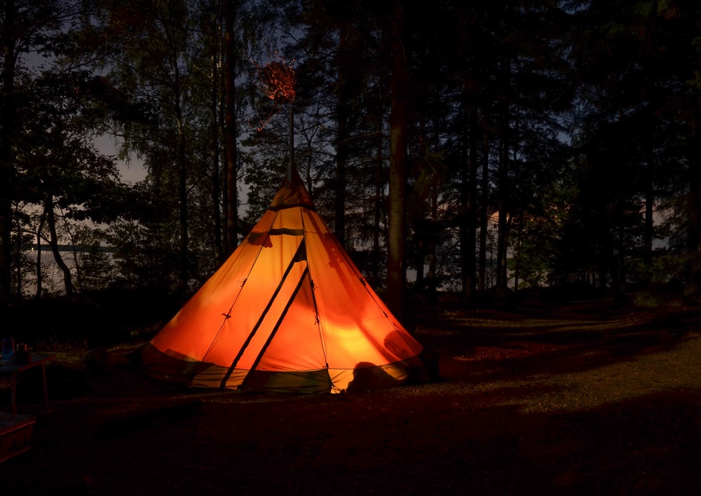 camping tent in forest during night