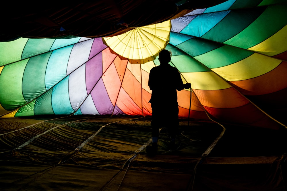 person holding parachute