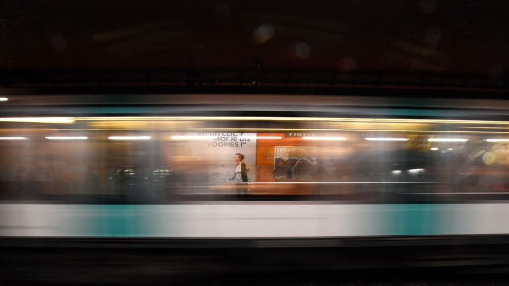 time lapse photo of woman inside a train