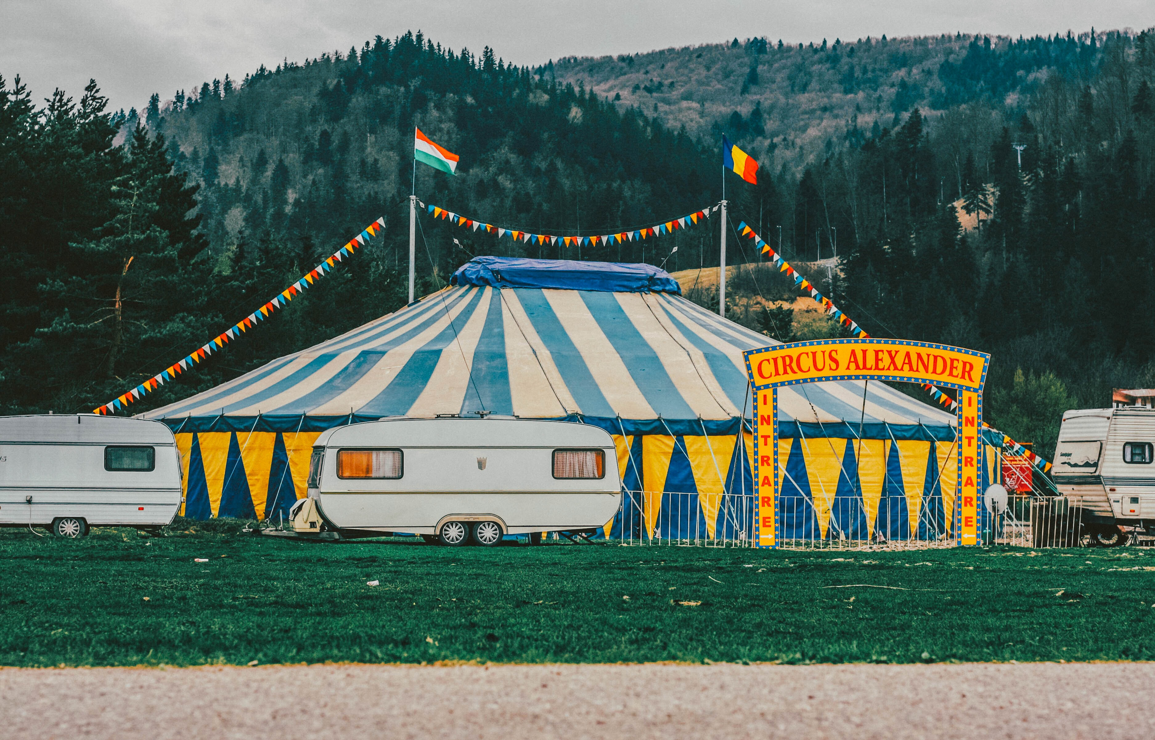 Caravans around a circus tent in the mountains