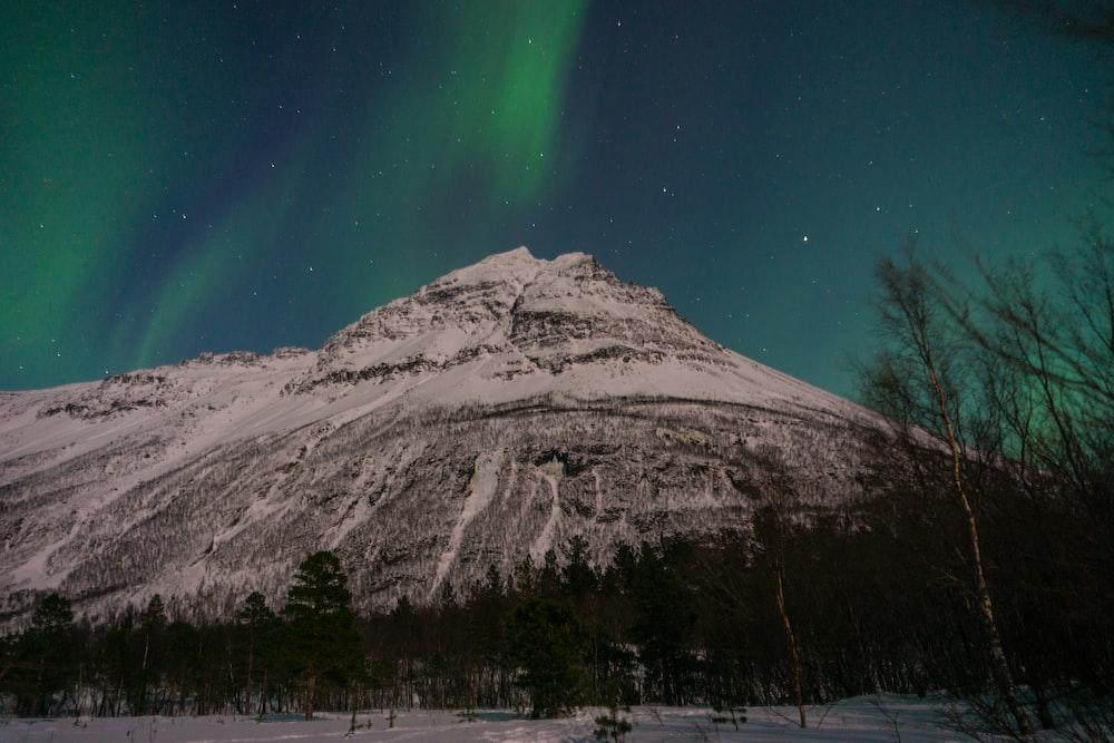 landscape photography of snow mountain under aurora borealis