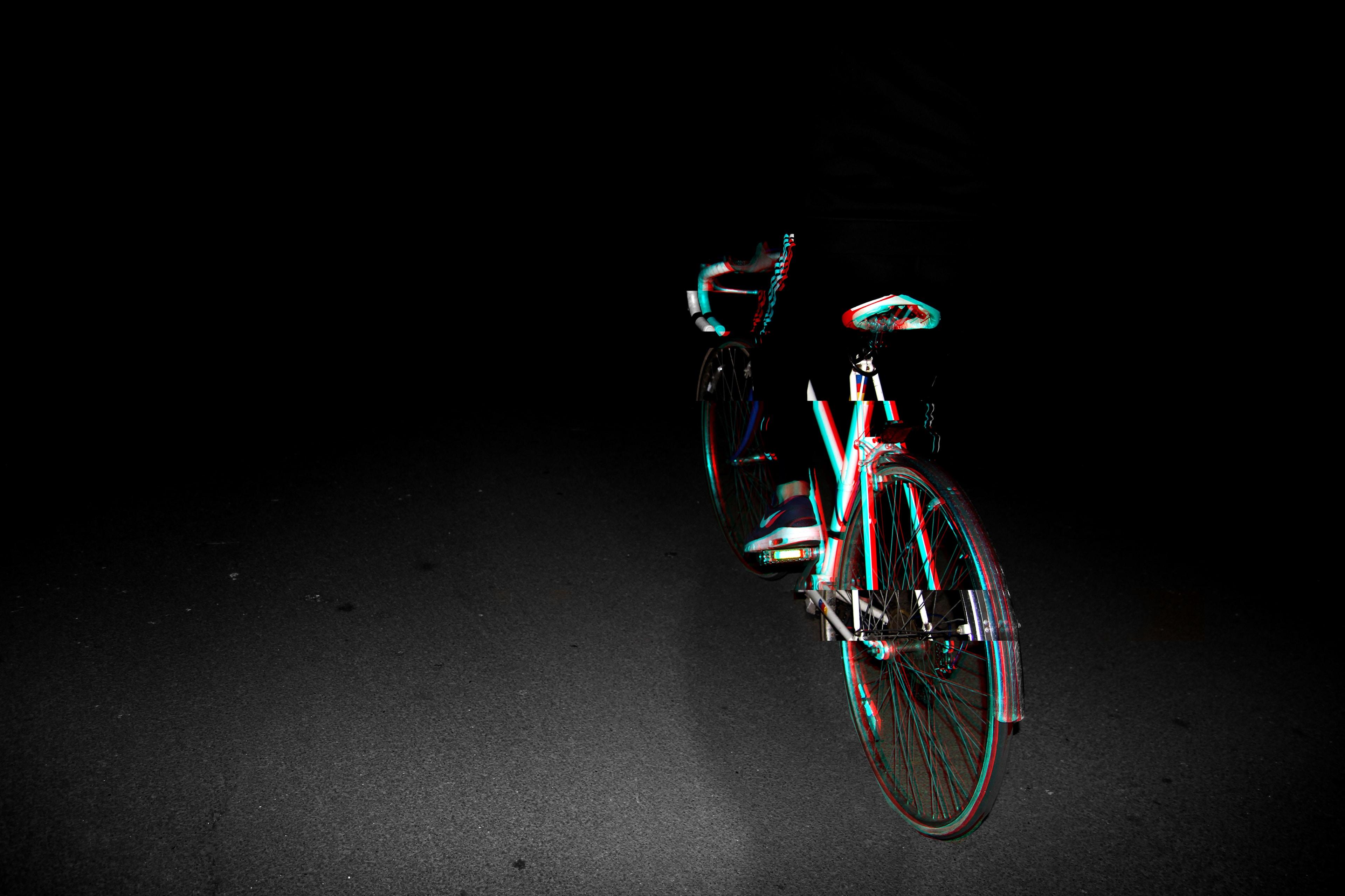 photo of blue and black road bike