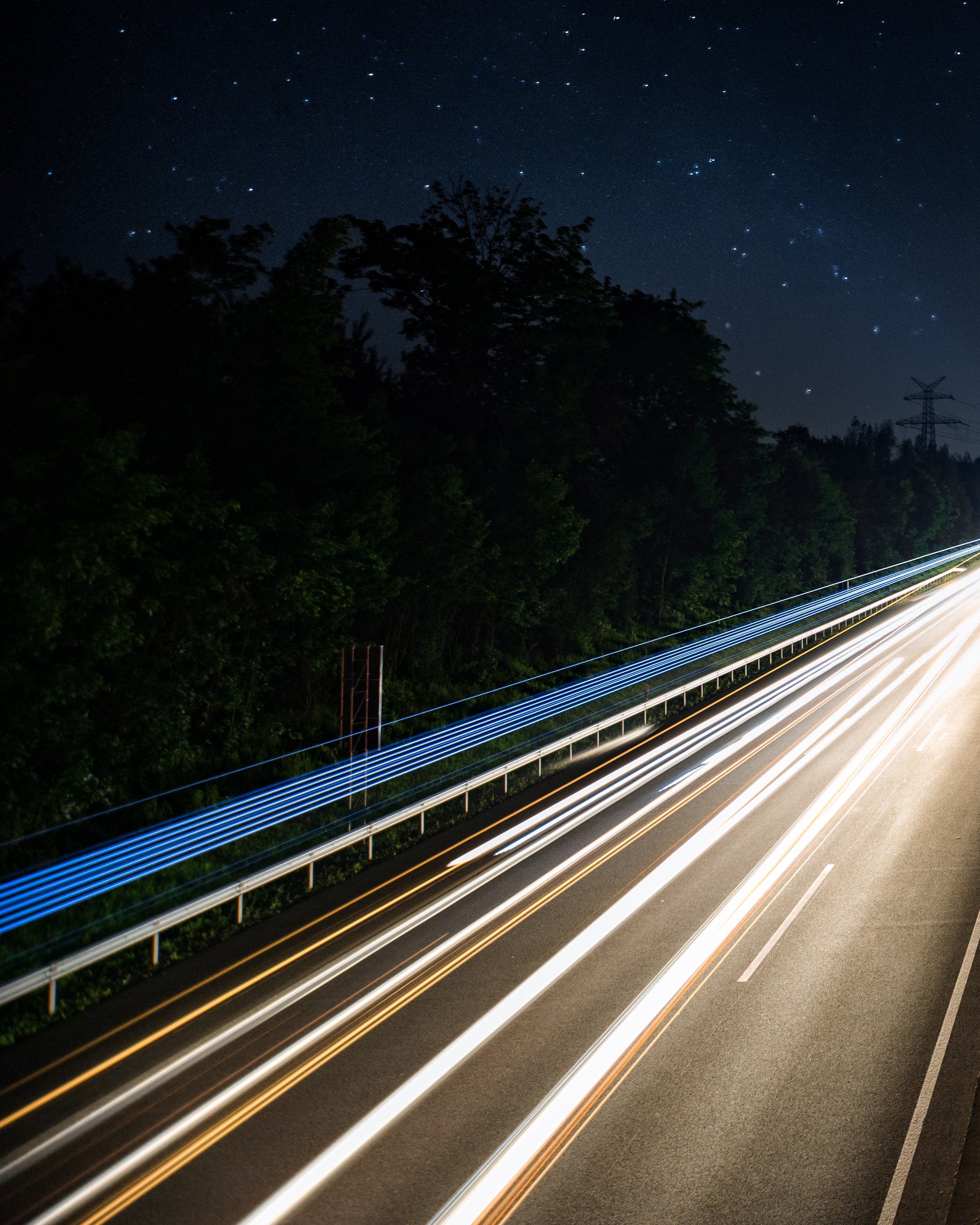 A fast-paced headlight trail image displaying speedy road movement at night