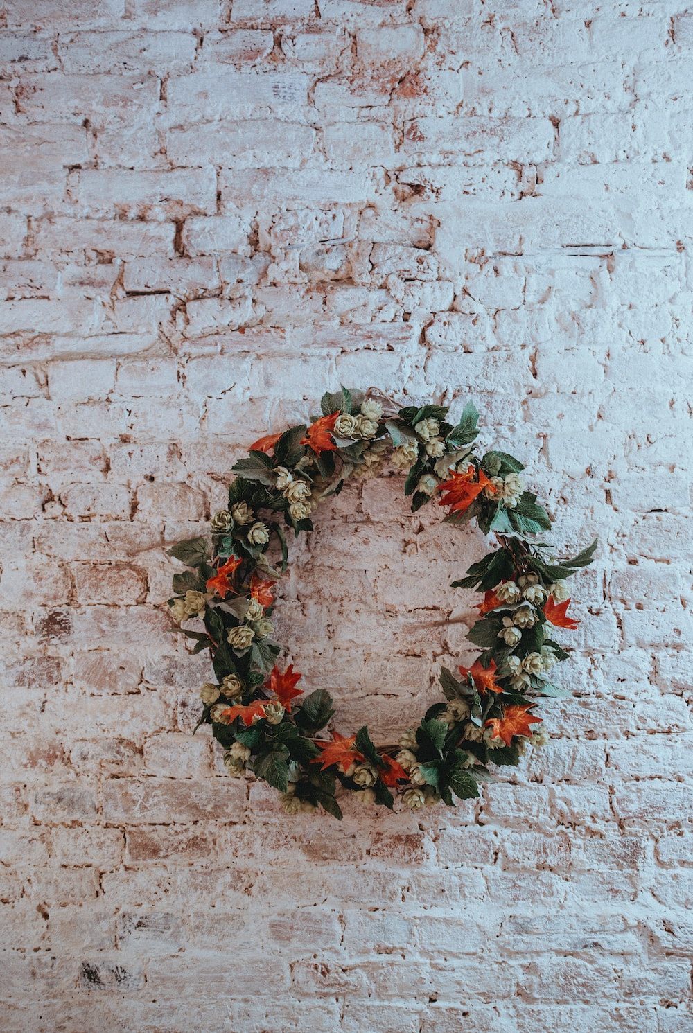 green, white, and orange floral wreath